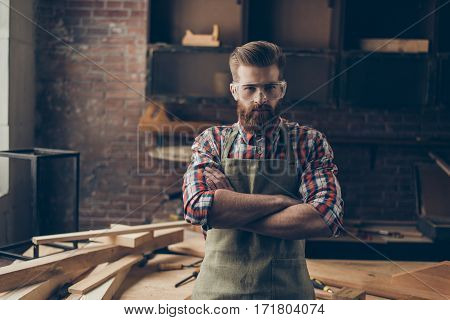 Serious Successful Handsome Joiner Look At Camera Near Tabletop With Tools.  Stylish Young Entrepren