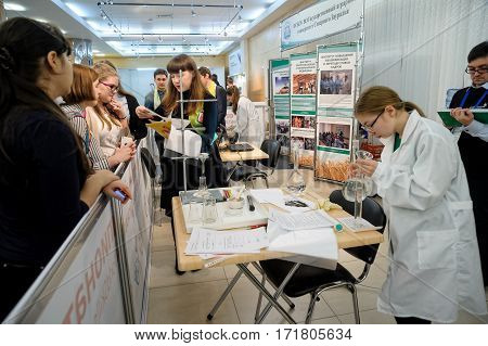 Tyumen Russia - February 16. 2017: Open championship of professional skill among youth World skills Russia Tyumen - 2017. The specialist agroecologist makes an experiment