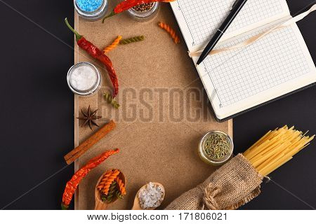 Open Notebook With Pen And Bunch Of Spaghetti