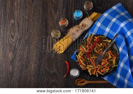 Dried Italian Pasta On Blue Plaid Tablecloth
