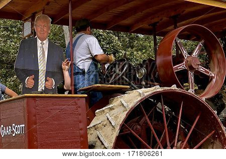 ROLLAG, MINNESOTA, Sept 1. 2016: The Gaar Scott steam engine operated by an unknown man carries a cutout image of Donald Trump at the West Central Steam Threshers Reunion parade in Rollag, MN attended by 1000's held annually on Labor Day weekend.