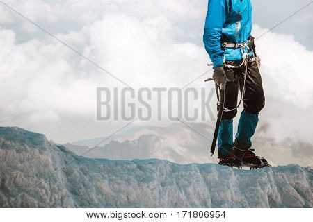 Man climbing on glacier to mountain summit Travel Lifestyle concept adventure active vacations outdoor mountaineering sport alpinism equipment ice axe and crampons