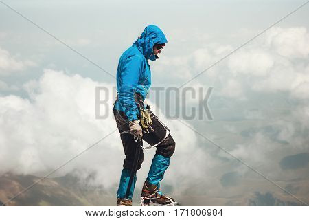 Man climbing to mountain summit Travel Lifestyle concept adventure active vacations outdoor mountaineering sport alpinism equipment ice axe and crampons