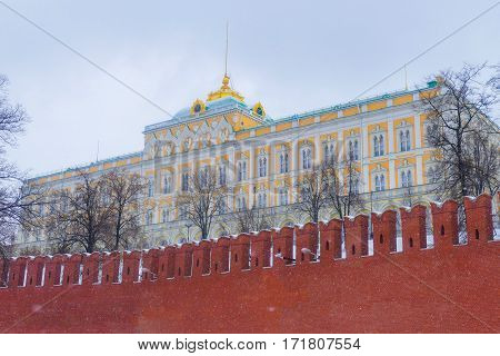 Kremlin Palace of Congresses in the winter on a background of the Kremlin wall