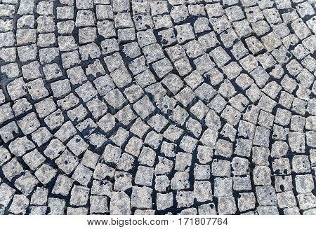 Grey detail cobble stone pavement background close
