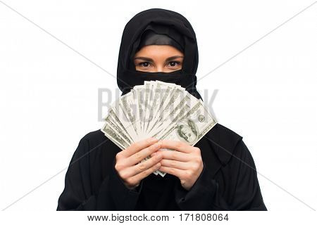 finances and people concept - muslim woman in hijab with money over white background