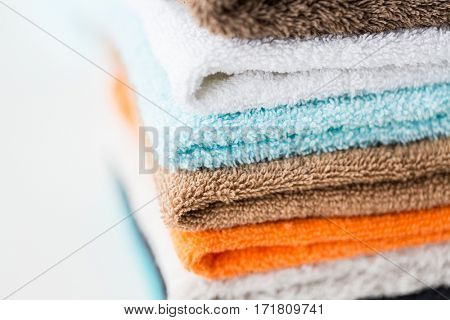 hygiene, fabric and textile concept - close up of stacked bath towels