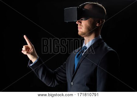 3d technology, virtual reality, cyberspace and augmented reality concept - young businessman with virtual reality headset or 3d glasses over black background