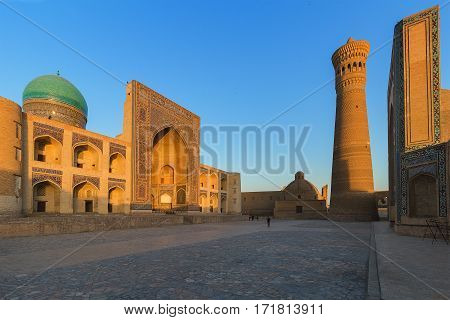 Yard of Poi Kolon complex at sunset in Bukhara, Uzbekistan. UNESCO world Heritage