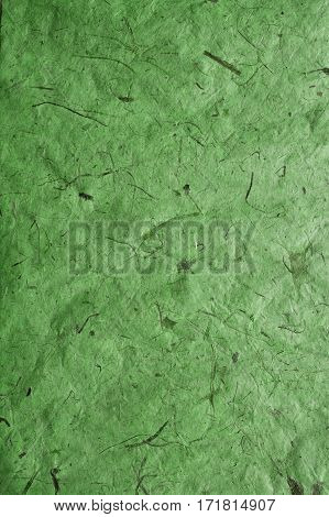 Green paper texture. Paper background. Recycled paper texture and background. Abstract  background and texture for designers. Old vintage paper. Green texture.