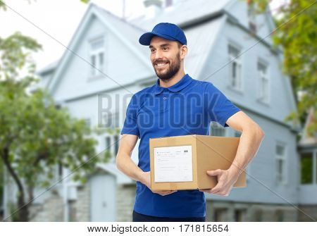 delivery service, mail, people, logistics and shipping concept - happy man with parcel box over house background