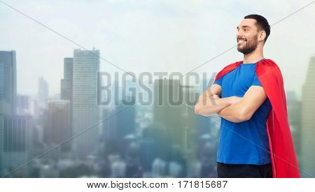power and people concept - happy man in red superhero cape over singapore city skyscrapers background