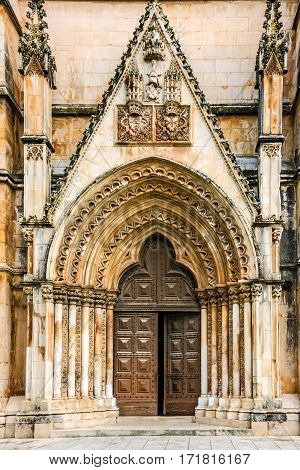 Entrance door to Batalha Dominican medieval monastery, Portugal - great masterpieces of Gothic art. UNESCO World Heritage