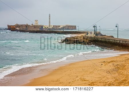 Cadiz, Spain. Beach seascape Castle of San Sebastian