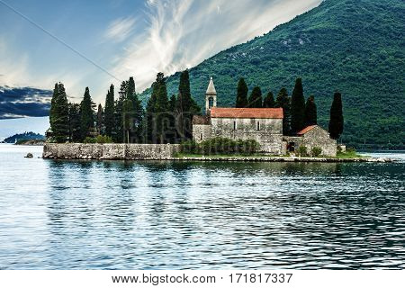 Montenegro seascape Monastery on the island in Perast