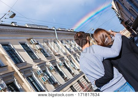 Beautiful Young Woman And Handsome Man Looking At The Rainbow