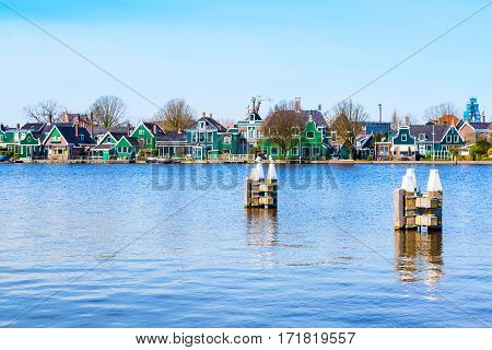 Row of old dutch green traditional houses in town Zaanse Schans in Netherlands, Holland near Amsterdam