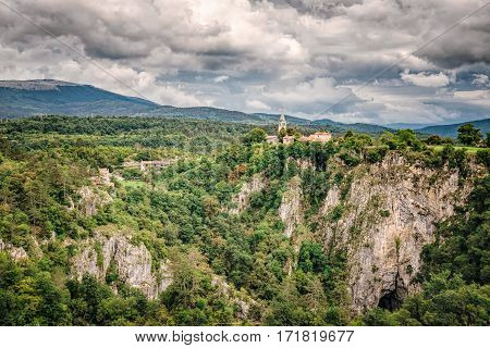 Areial view at Skocjan Caves with church on the edge.