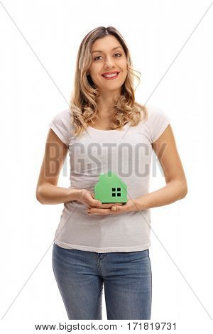 Young woman holding a model house isolated on white background