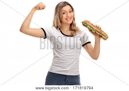 Happy woman flexing her biceps and holding a sandwich isolated on white background