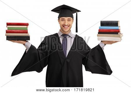 Happy graduate student holding two stacks of books isolated on white background