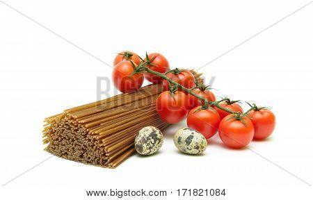 quail eggs tomatoes and spaghetti on white background close-up. horizontal photo.