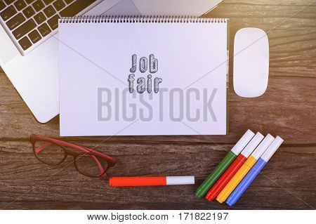 Job Fair Text On Wooden Desk With Tablet Pc And Keyboard.