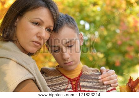upset mother with son portrait  close up