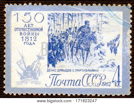 USSR - CIRCA 1962: Postage stamp printed in USSR shows Russians partisan with the inscription