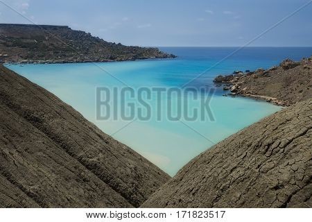 Malta nature, cliffs in malta, Ramla Bay in Malta, maltese landscape with the hill and different blue colour sea on sunny day, scenic view of Malta island nature