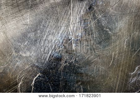 Close up scratched metal texture. Grunge background