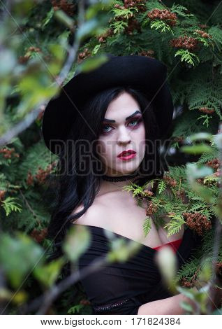 Beautiful Witch In The Forest. Halloween.