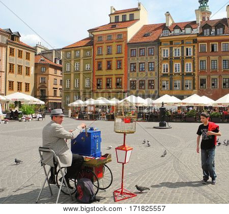 Warsaw Poland - May 5 2015: The organ grinder on Market Square of the old town.