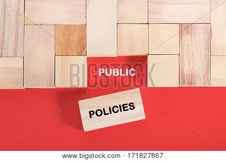 Wooden cube with a word PUBLIC POLICIES