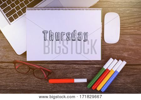 Thursday Text On Wooden Desk With Tablet Pc And Keyboard.