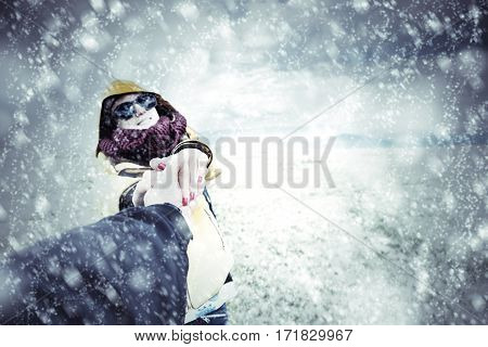 Couple enjoying on the snow in nature.