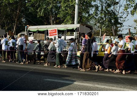 Protesters marching peacefully in Yangon. February 22 2014 - Yangon Myanmar