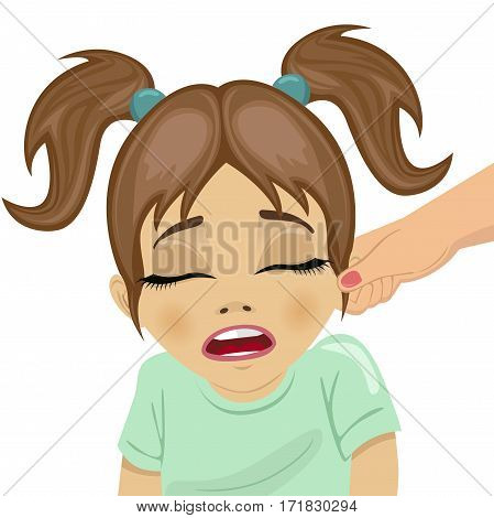 mother pulling a daughter's ear over white background