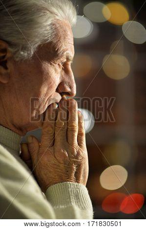 Portrait of a upset mature man close up