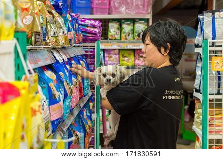 Women And Her Dog Shop At Pet Shop