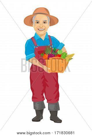 elderly male gardener wearing overalls carrying a basket of fresh vegetables