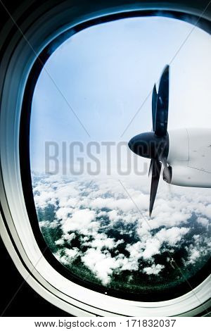 Plane propeller captured while airplane flying over the sky