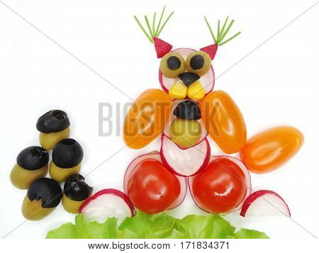 creative funny vegetable food snack with tomato squirrel with nuts