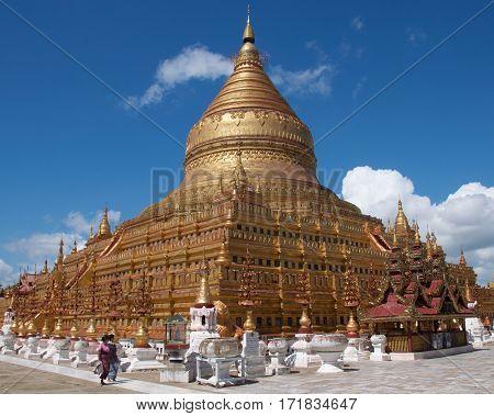 Bagan, Myanmar - October 2015: Worshippers  visiting Shwezigon Pagoda, a Buddhist temple in Bagan, Myanmar