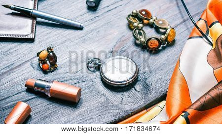 Fashion set of female accessories. Jewelry, lipctick and pocket watch