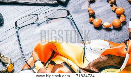 Fashion set of female accessories. Necktie, glasses and jewelry