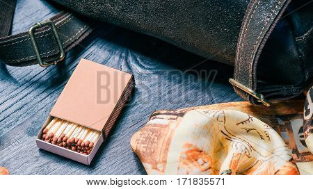 Fashion set with brown leather backback and matchbox