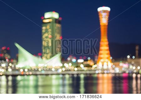Twilight blurred bokeh lights Kobe port tower sea front abstract background