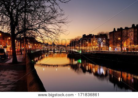 DUBLIN, IRELAND - DEC 28: Liffey Bridge known as Ha'penny Bridge is a pedestrian bridge over the river Liffey in Dublin City Centre on Dec 28, 2016 in Dublin, Ireland. Built in 1816 of cast iron