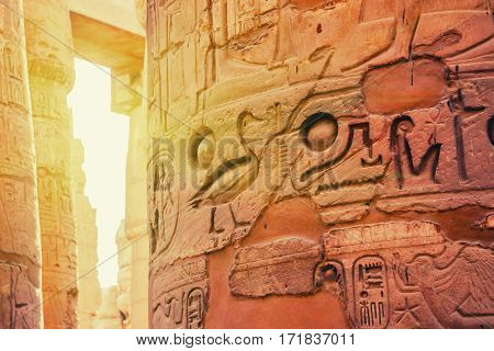 Hieroglyphs on walls of Hypostyle Hall in Karnak Temple located in ancient Thebes, Egypt